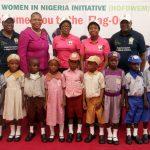 Wife of Lagos State Governor & Founder of Hope for Women in Nigeria Initiative (HOFOWEM), Mrs. Bolanle Ambode (middle); C.E.O, HOFOWEM, Mrs. Oyefunke Olayinka (2nd right); Chairman, Lagos State Universal Basic Education Board (LSUBEB), Dr. Ganiyu Shopeyin (right); Permanent Secretary, Ministry of Education, Mrs. Adebunmi Adekanye (2nd left); Secretary, LSUBEB, Mrs. Abosede Adelaja (left) and some fully kitted pupils of public primary schools in Lagos State
