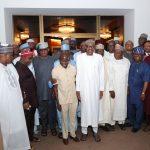 President Muhammadu Buhari flanked by APC National Chairman Adams Oshiomhole, Senate Majority Leader Sen Ahmad Lawal and others