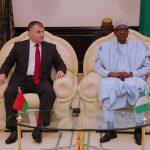 R-L; President Muhammadu Buhari chats with the outgoing Ambassador of Belarus to Nigeria, Mr. Vyacheslav Beskosty