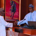 R-L; President Muhammadu Buhari swears-in Former AIG Alhaji Lawal Bawa Rtd