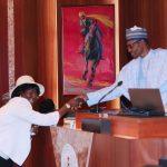 R-L; President Muhammadu Buhari swears-in Hon Justice Clara Bata Ogunbiyi Rtd