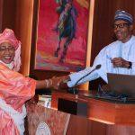 R-L; President Muhammadu Buhari swears-in Hajiya Najatu H. Muhammad