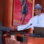R-L; President Muhammadu Buhari swears-in Mr. Braimoh Adogame Austin