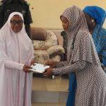 Commissioner of Women Affairs, Katsina state, Badiyya Hassan Mashi (left) presenting cash to a beneficiary.