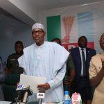 President Muhammadu Buhari (M) flanked by the Vice President Yemi Osinbajo, APC National Chairman, Comrade Adams Oshiomhole