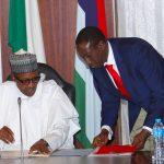 President Muhammadu Buhari confers with NSA Major General Babagana Munguno