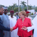 R-L; President Muhammadu Buhari, German Chancellor H.E Angela Merkel in a handshake with Minister of Foreign Affairs, Mr Geoffrey Onyeama, SGF, Mr. Boss Mustapha and Chief of Staff, Mallam Abba Kyari