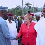 R-L; President Muhammadu Buhari, German Chancellor H.E Angela Merkel in a handshake with SGF, Mr. Boss Mustapha and Chief of Staff, Mallam Abba Kyari