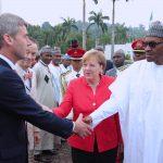 R-L; German Chancellor, H.E Angela Merkel introduces his delegation Foreign Policy Advisor, Mr Jan HAecker to President Muhammadu Buhari