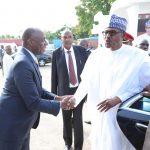 President Muhammadu Buhari being received by Minister of Transportation, Mr Rotimi Amaechi