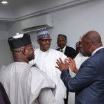President Muhammadu Buhari listens as Minister of Transportation, Mr Rotimi Amaechi