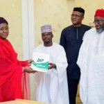 Comrade Garba Bello presenting a project document to Mrs. Buhari, with him are Prince Odinaka Ohaekelem and Chief Emeka Odimegwu Ojukwu Jr.