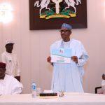 President Muhammadu Buhari displays the form