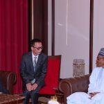 President Muhammadu Buhari chats with the New Ambassador Republic of Korea to Nigeria, H.E Comrade Jon Tong Chol, his interpreter and First Secretary, Kim Chon Il (M)