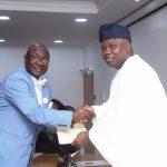 Lagos State Governor, Mr. Akinwunmi Ambode (right), congratulates Mr. Samson Ajibade, after his swearing-in as Permanent Secretary, Public Service Office
