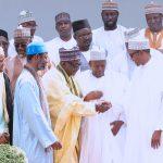 President Muhammadu Buhari in a handshake with Alhaji Muhammad, Cheikh Buba Niass, Sherif Hadi Nema, Cheikh Moustapha Niass, Sheikh Ibrahim Sheikh Maihula, Imam Nasir Adam and others