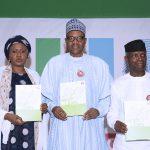 President Muhammadu Buhari, Wife, Aisha and Vice President Yemi Osinbajo at the launch of Next level a scorecard of Buhari/Osinbajo