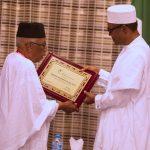 President Muhammadu Buhari Receives a plague as the grand Patron of Nigerian Conversation Foundation