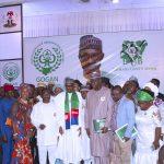President Muhammadu Buhari (M) flanked by SGF, Mr. Boss Mustapha, Chairman and National Co-ordinator of Good Governance Ambassadors of Nigeria, Chief Felix Idiga and others